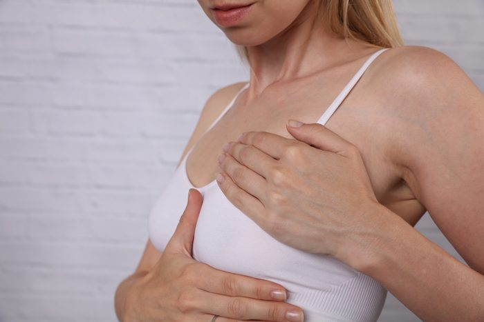 Woman Checking Her Breast, health care and prevention concept