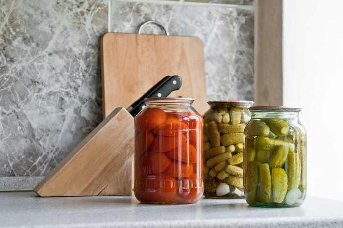 pickled cucumber and tomato in glass on the kitchen table