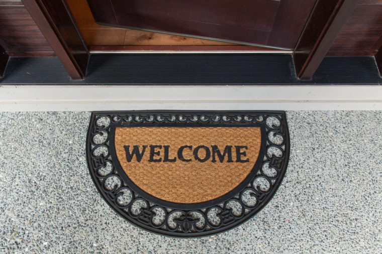 Welcome door mat with open door.