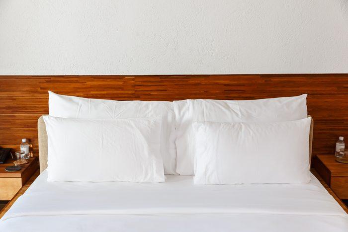 white pillows on the white bed
