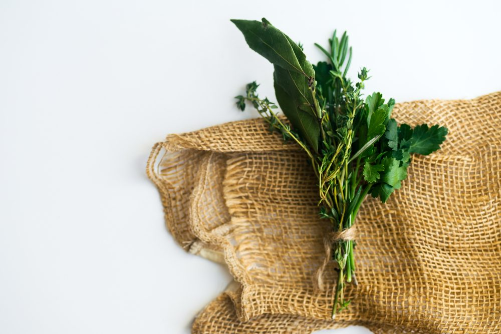 fresh herbs on top of burlap
