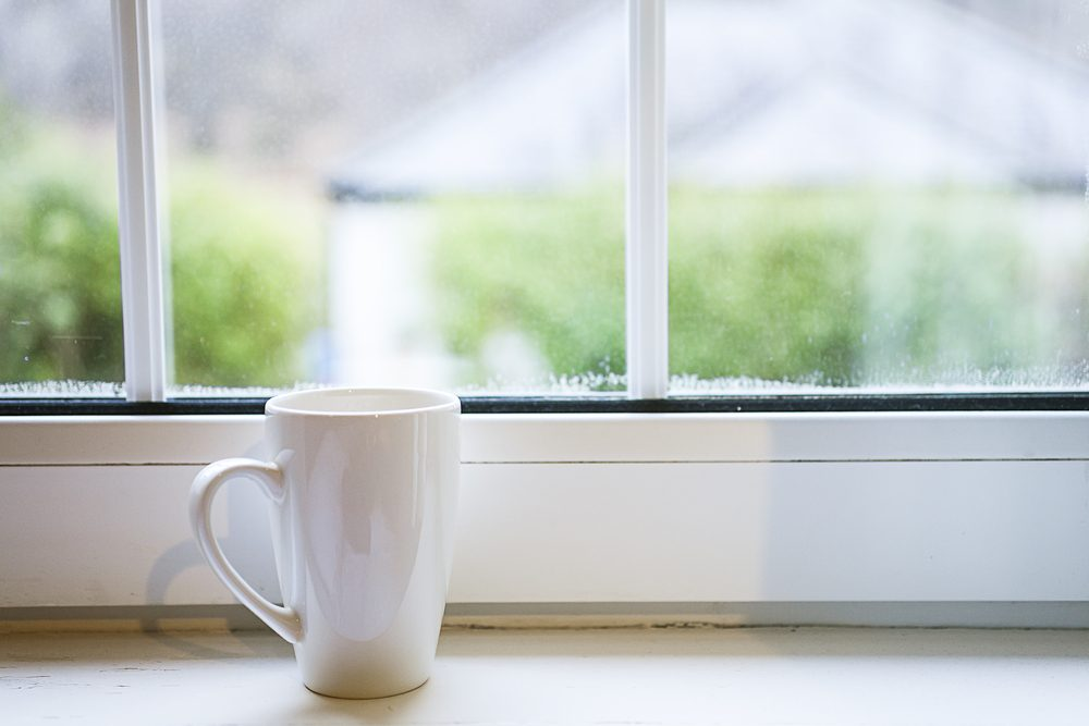 Coffee cup near window