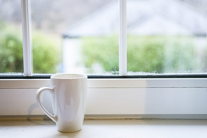 Coffee cup near window