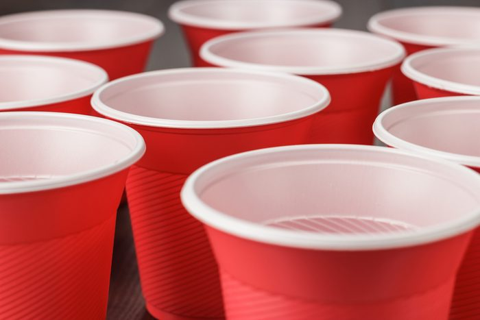 disposable red plastic cups on the wooden table