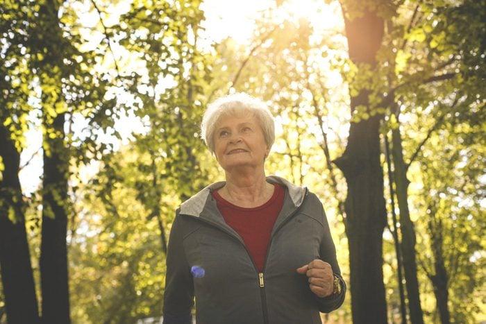 Smiling senior woman having recreation in park.