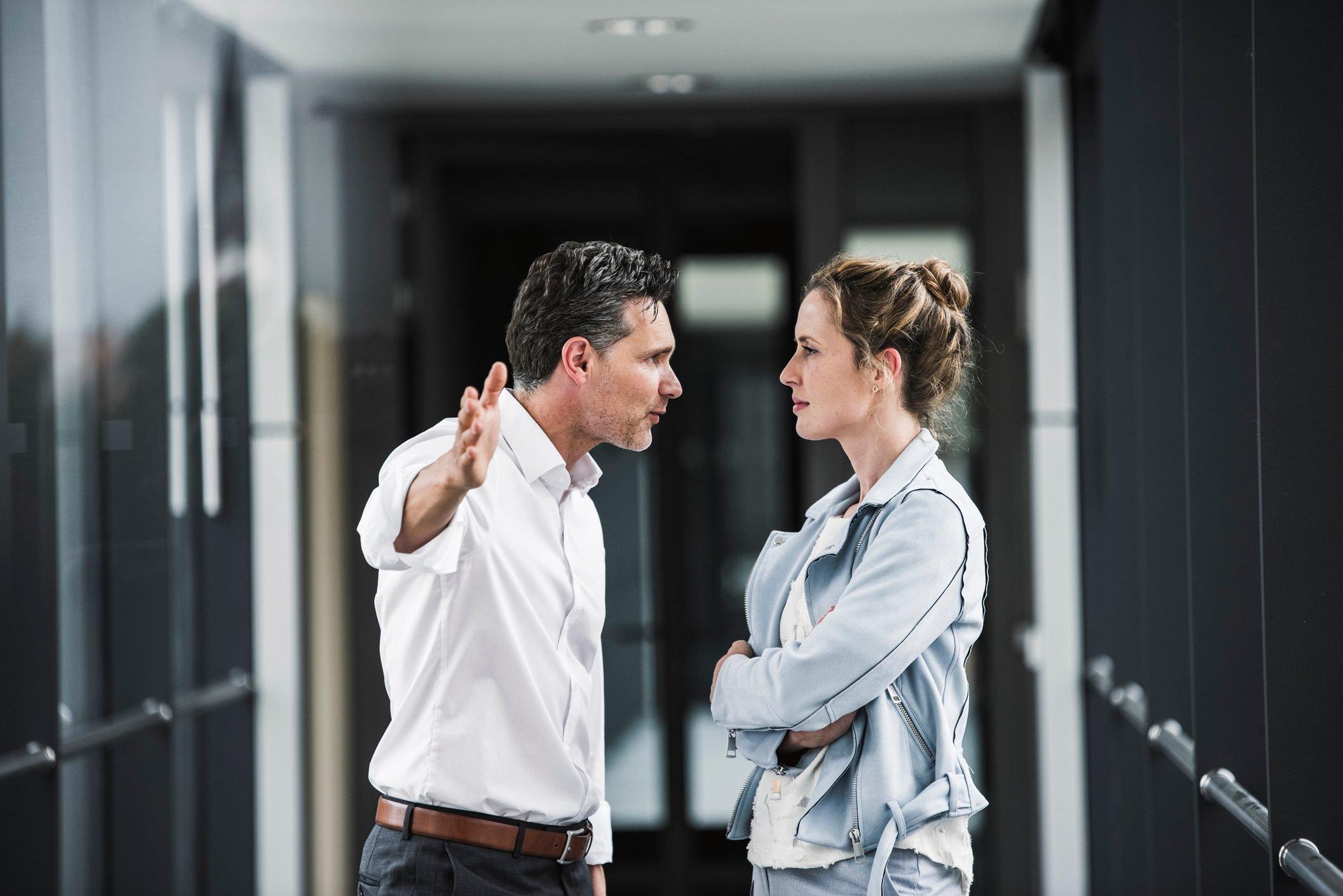 businessman and businesswoman arguing