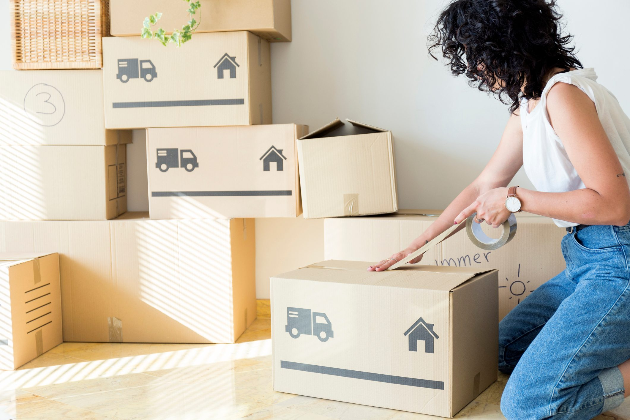 woman packing up boxes for moving