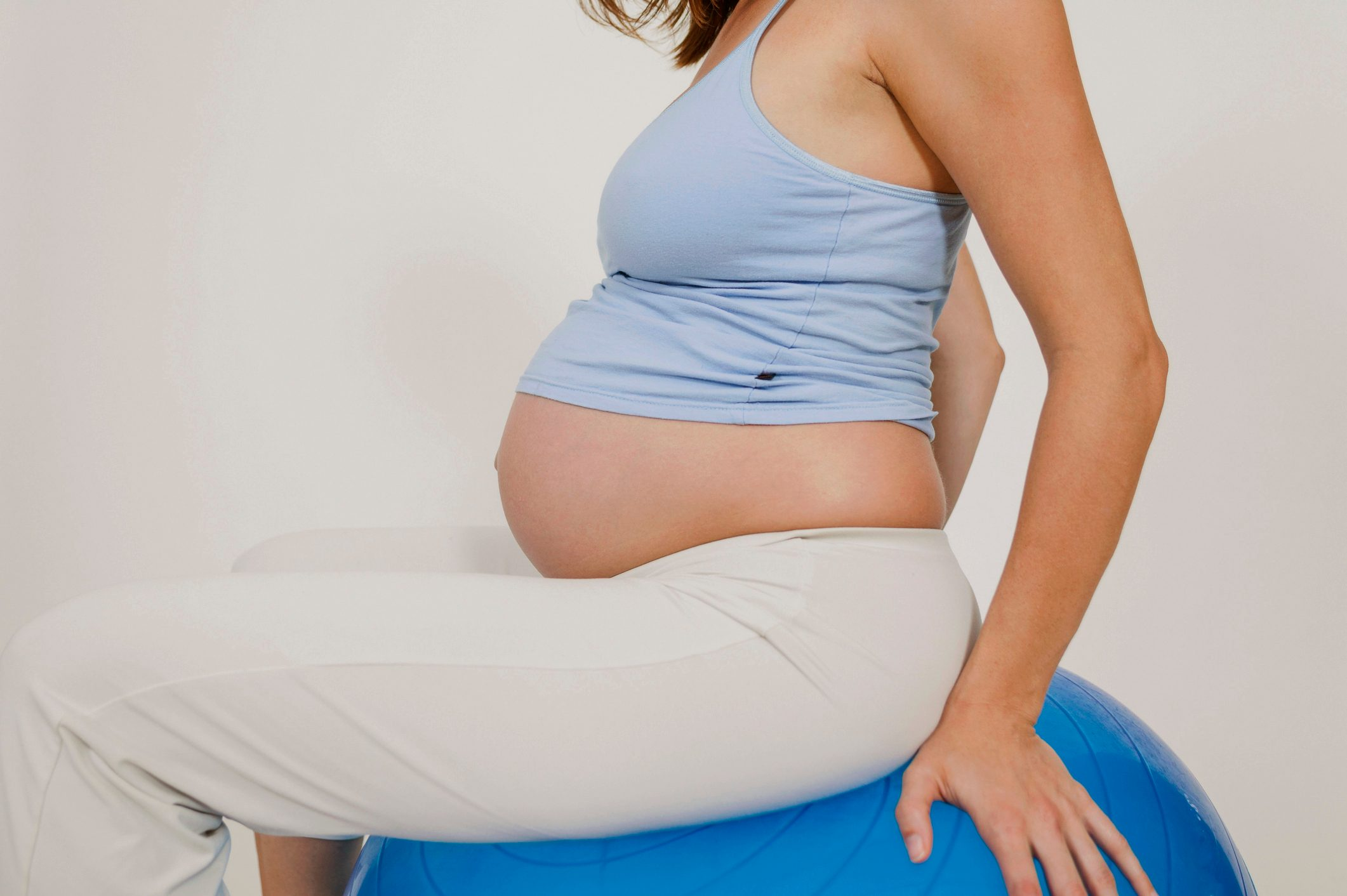 pregnant woman sitting on exercise ball during labor