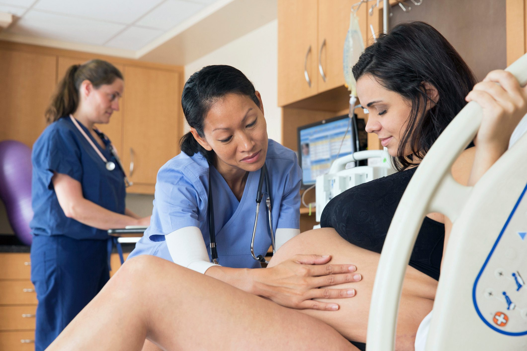 doctor assisting woman in labor