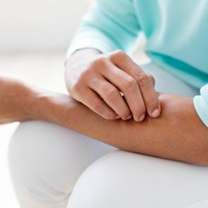 woman itching arm