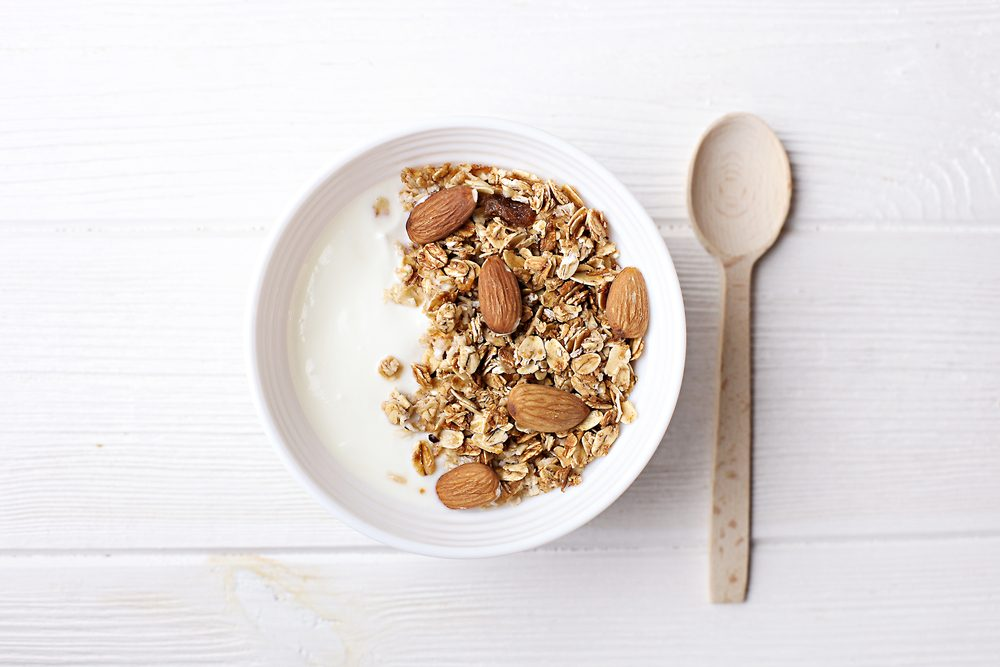 bowl of granola with yogurt and milk