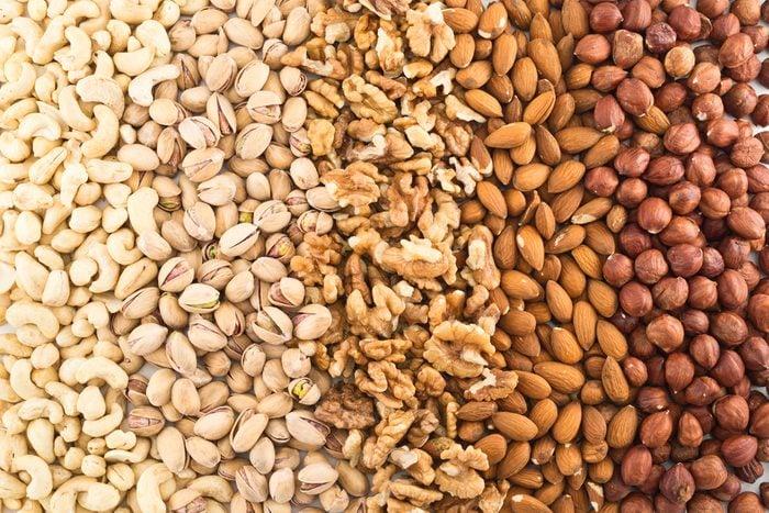 Surface covered with different nut mix of hazelnut, pistachio, peanut, almond, walnut