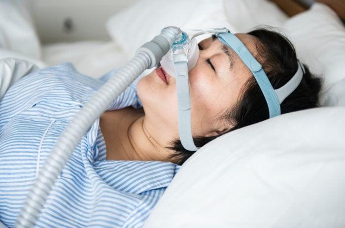 A woman wearing anti-snoring chin straps