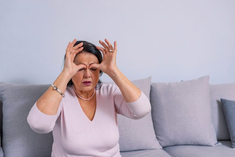 woman sinus issue nasal hands on forehead