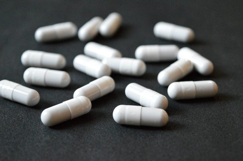 White pill capsules
