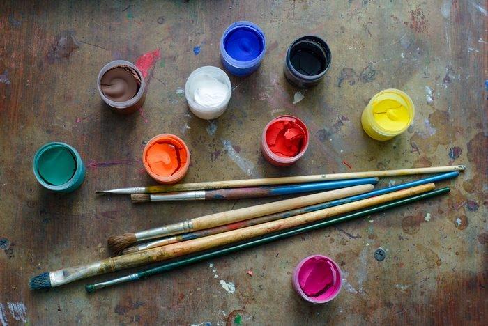 Set of brushes and paints on the table