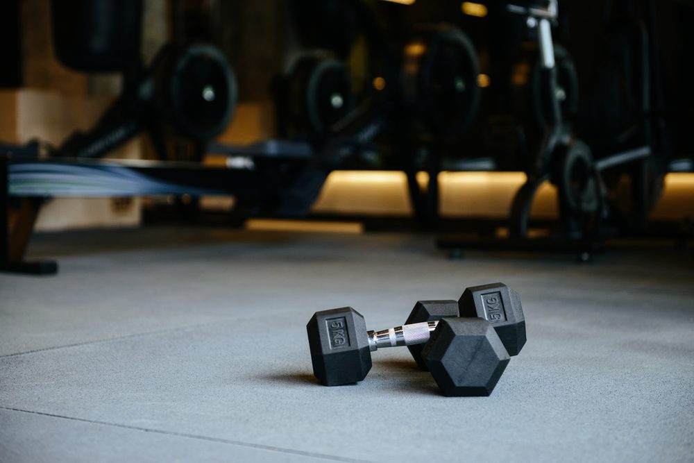 Photo of dumbbells which lying on the floor in gym
