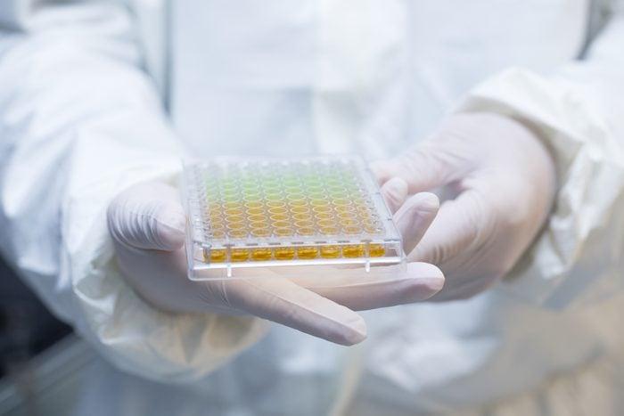 scientist holding laboratory test