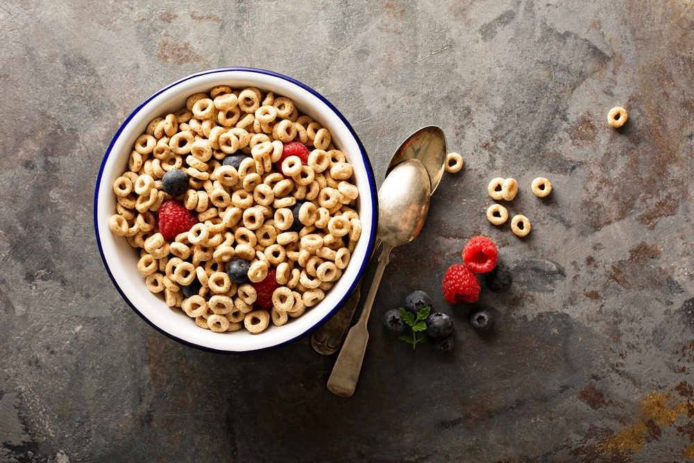 bowl of cereal O's with raspberries and blueberries