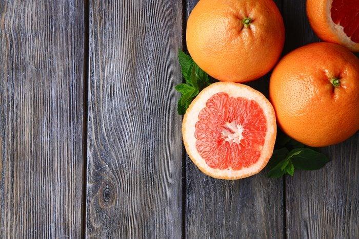 Whole grapefruits and a half grapefruit