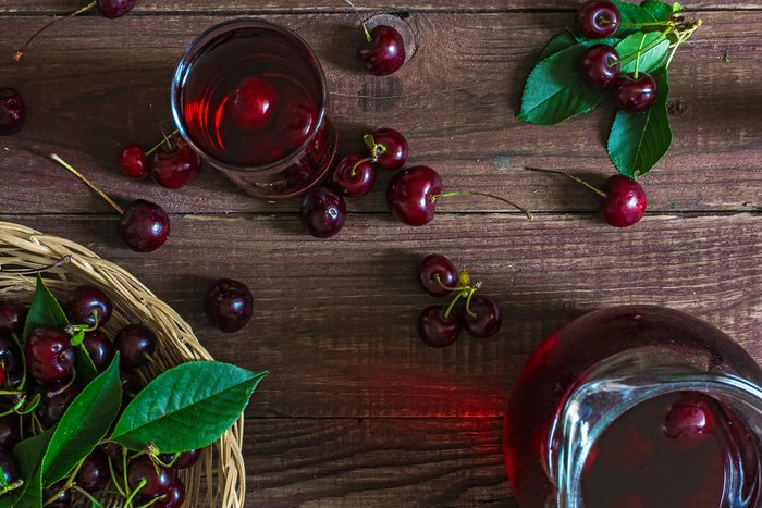 bowl of cherries, cherries on table, and cherry juice