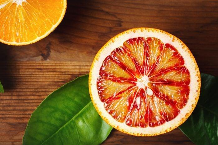 Half of blood orange and orange