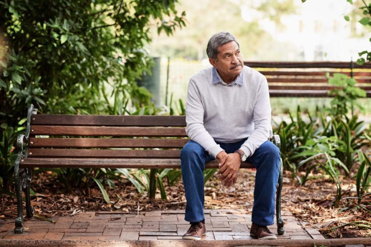 older man sitting on park bench
