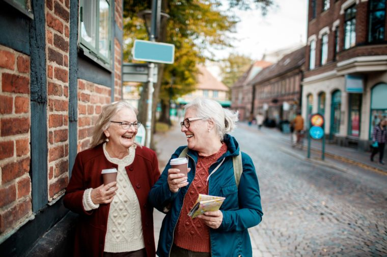 elderly women getting coffee and talking together
