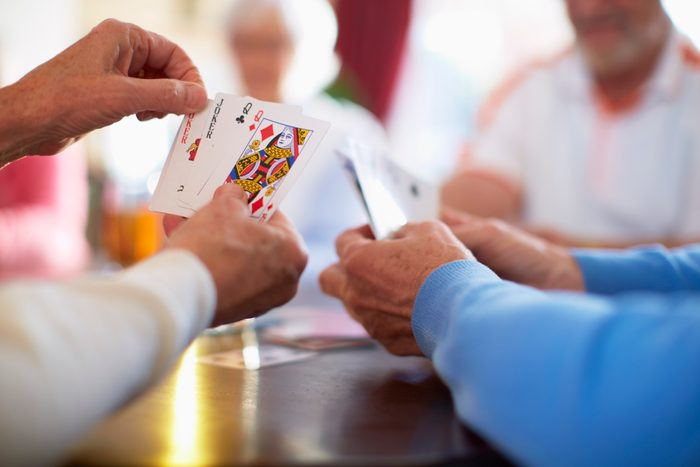group of friends playing card games