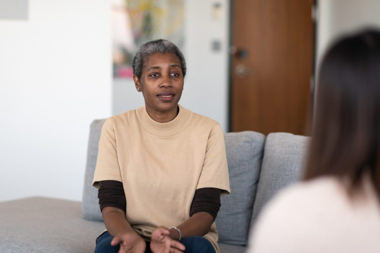 woman talking to therapist