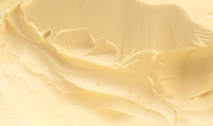 Closeup of a spreadable yellow butter.