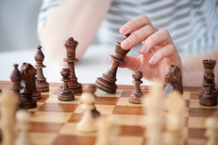 close up of woman playing chess
