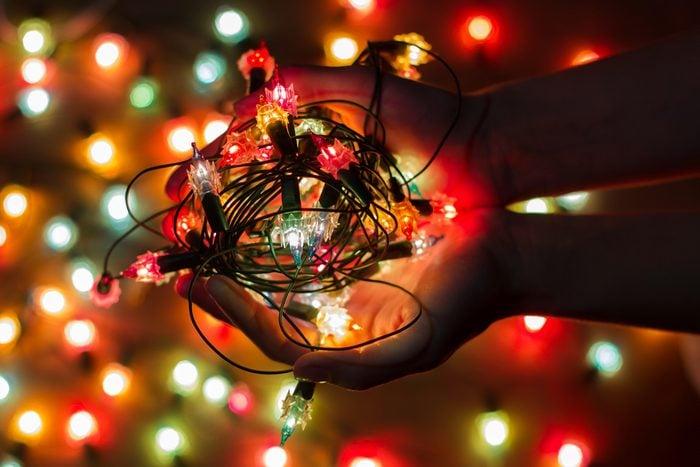 Christmas light bulbs in hands