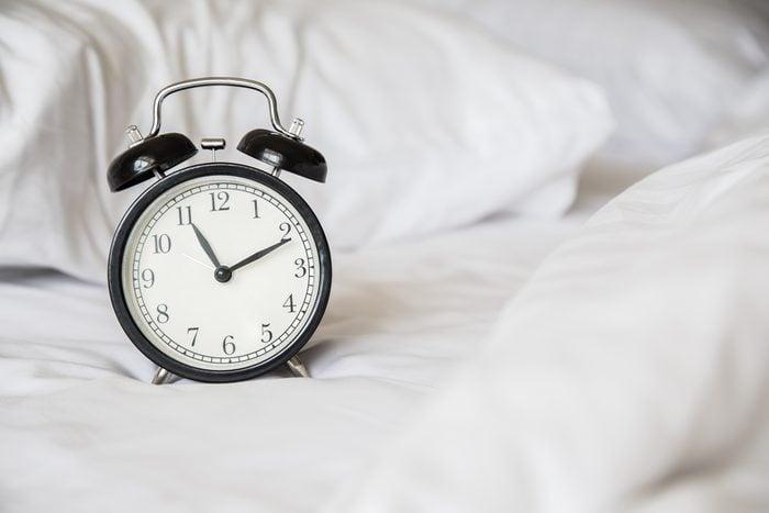 Retro alarm clock on the bed