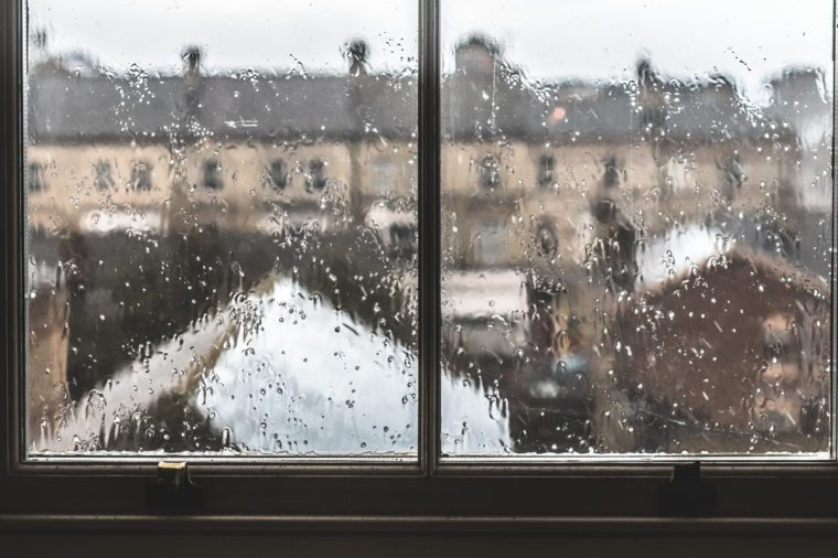 Gloomy rainy window with a view on provincial english town