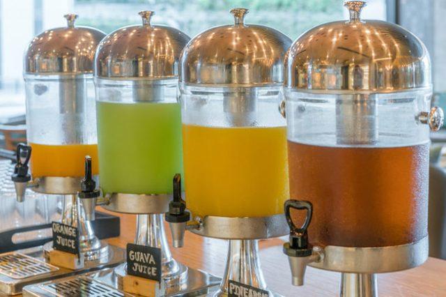 Row of fresh juice at buffet restaurant.