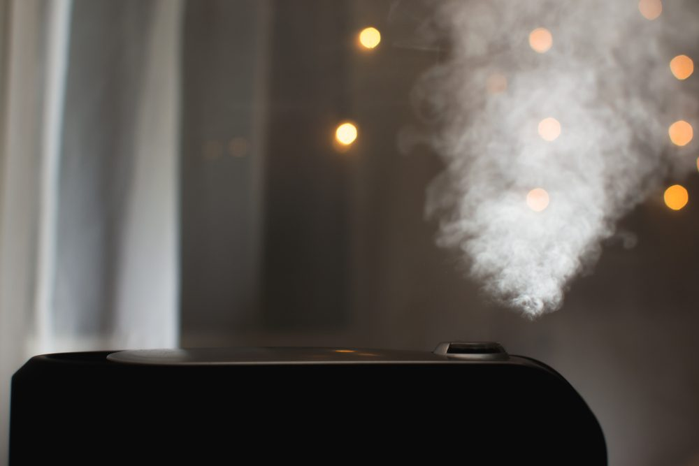 Humidifier emitting steam in a dark room