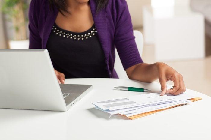 woman paying bills at laptop