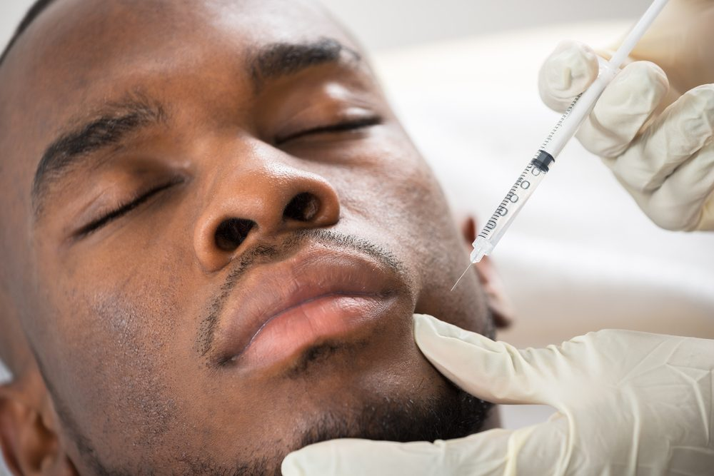 man getting filler injection in face