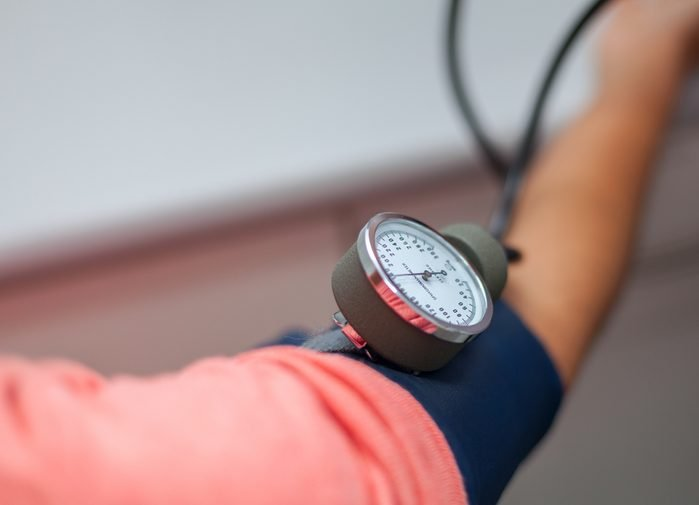Doctor Checking Blood Pressure Of A Patient Close Up stock photo