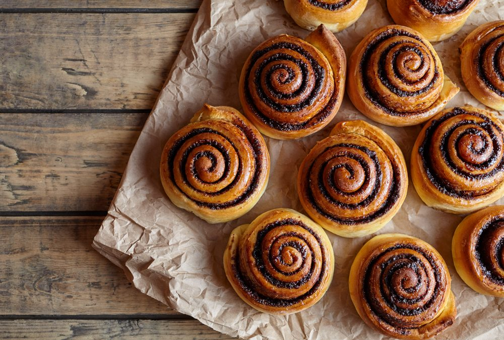 Freshly baked cinnamon buns with spices and cocoa filling