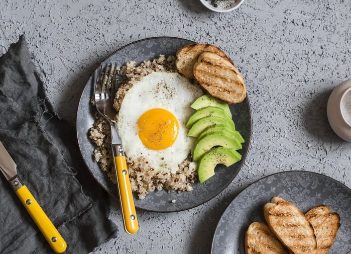 Quinoa and egg breakfast bowl. Healthy breakfast or snack. Top view, flat lay