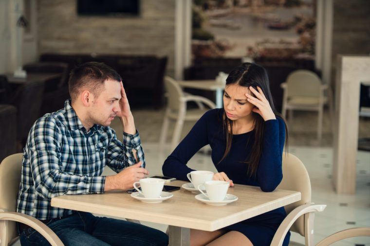 Young couple arguing in a cafe