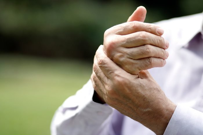 close up of man's hands with arthritis