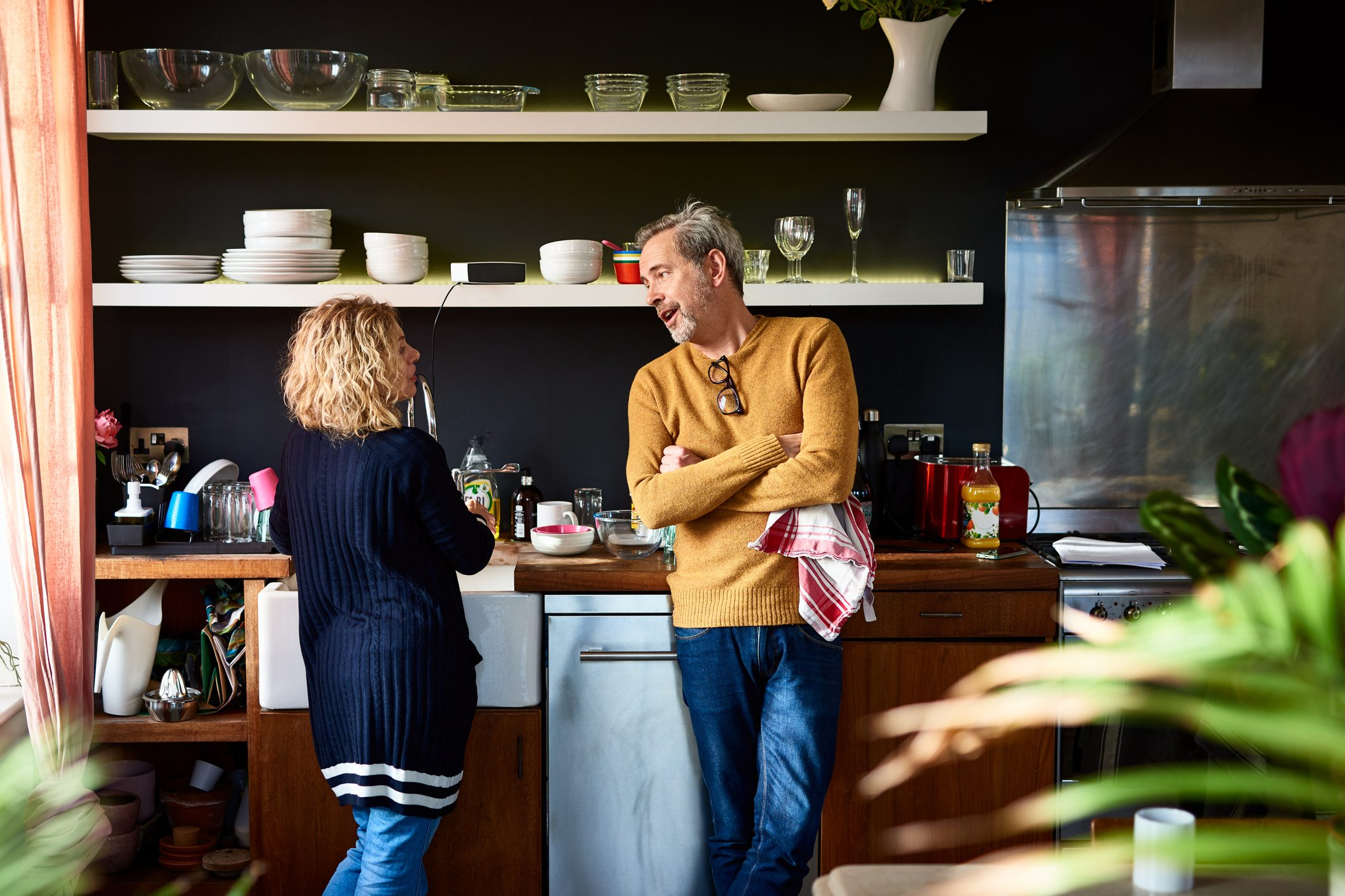 mature couple having a conversation in the kitchen
