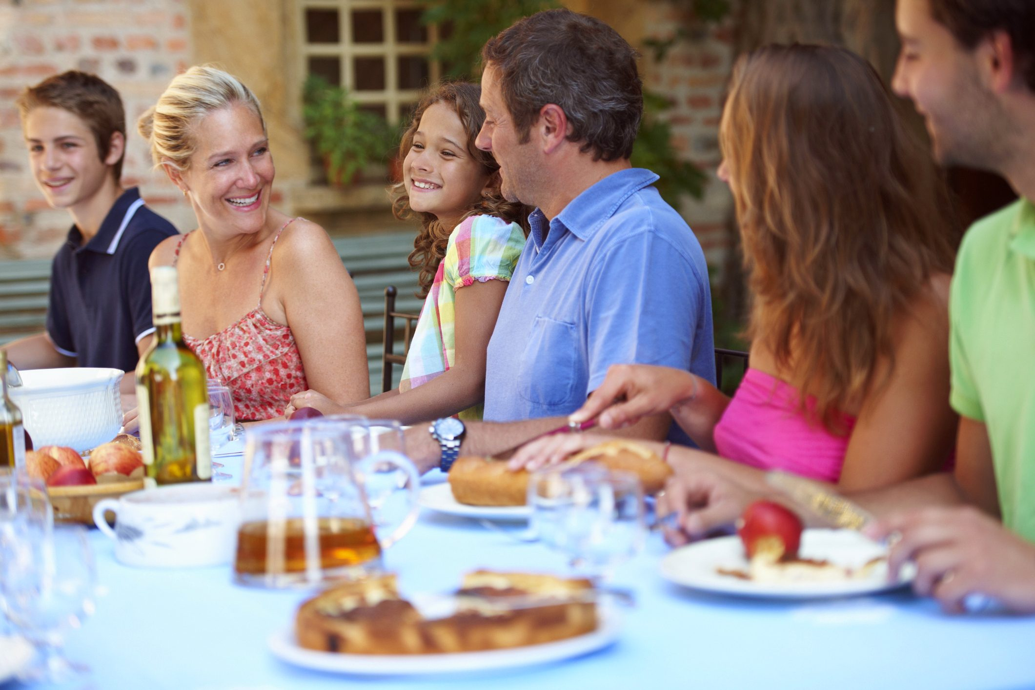family laughing and talking during dinner