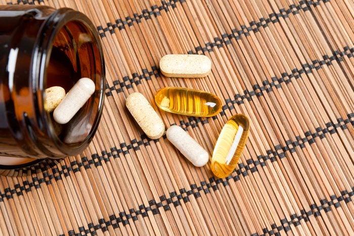 Dietary supplement. multivitamin tablets in a brown medicine bottle