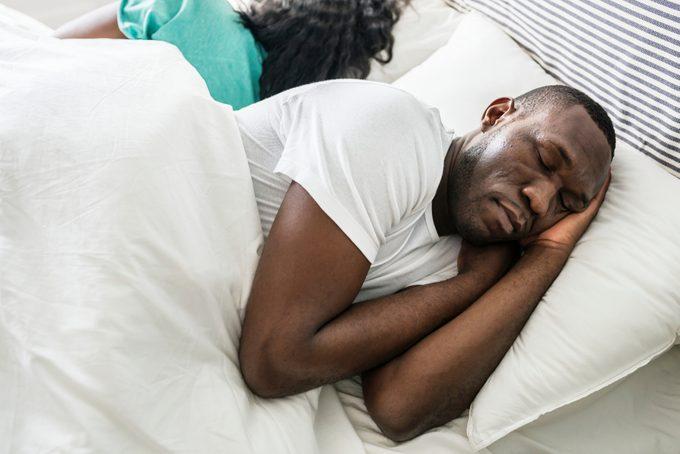 Black couple sleep together