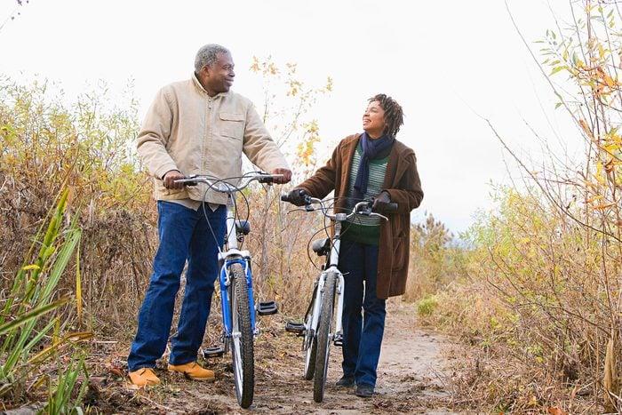 senior couple biking