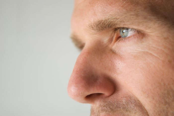 sinus infection close up of man's nose